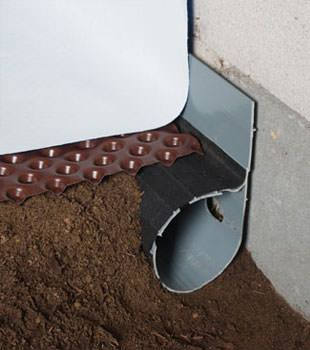 Closeup of a crawl space drainage system installed in Whittier