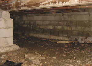 Rotting, decaying crawl space wood damaged over time in Sylva